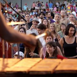 audience watching band playing music on stage