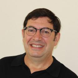 Juan Restrepo in front of white backdrop