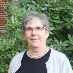 Heidi Schellman in front of Kidder Hall