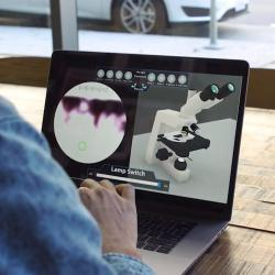 student using 3d virtual microscope o their laptop in coffee shop