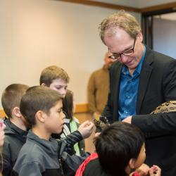 Roy Haggerty showing kids snake at Discovery Days