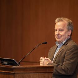 Doug Keszler talking behind podium