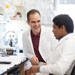 Rich Carter talking with student in lab