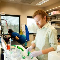 Colin Johnson working with samples in lab