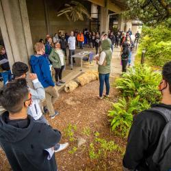 TRACE workers standing in outdoor meeting space in Newport