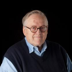 Walter Loveland standing in front of black backdrop