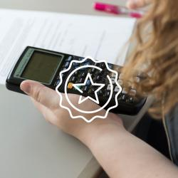 star icon above image of student working on homework with calculator