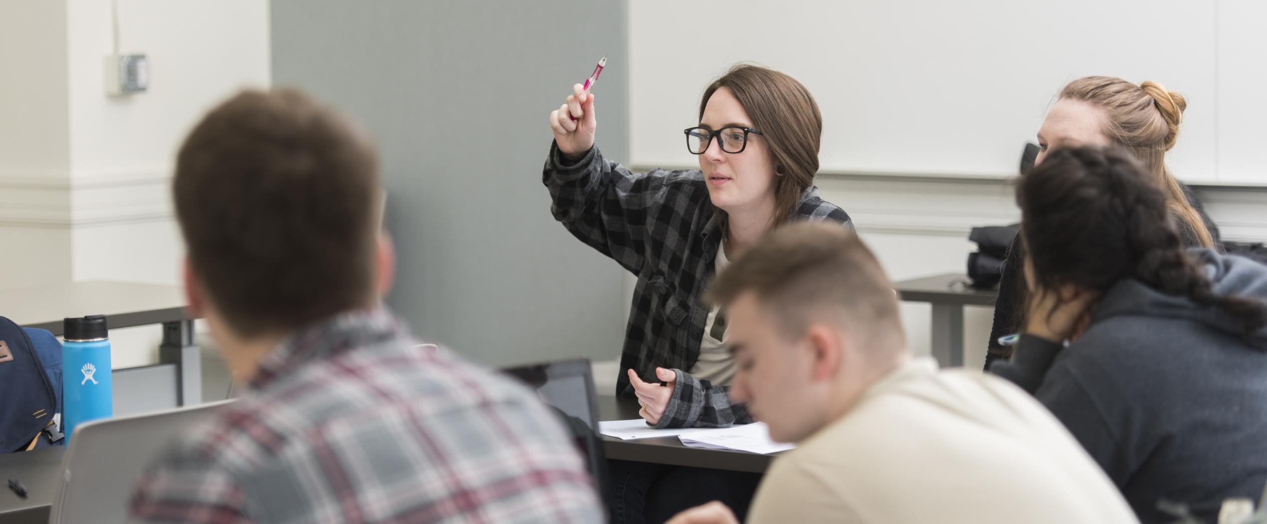 female student raising her hand in class