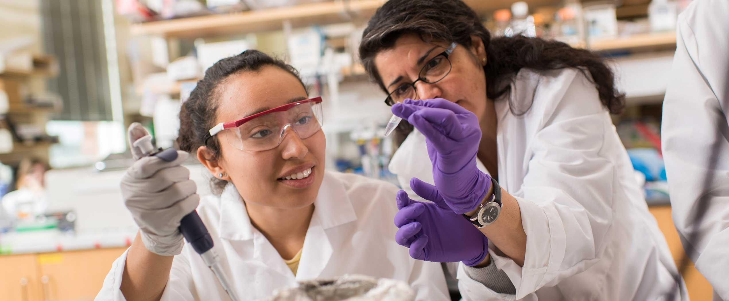 Luz Jovita Dimas with Viviana Perez analyzing samples in lab
