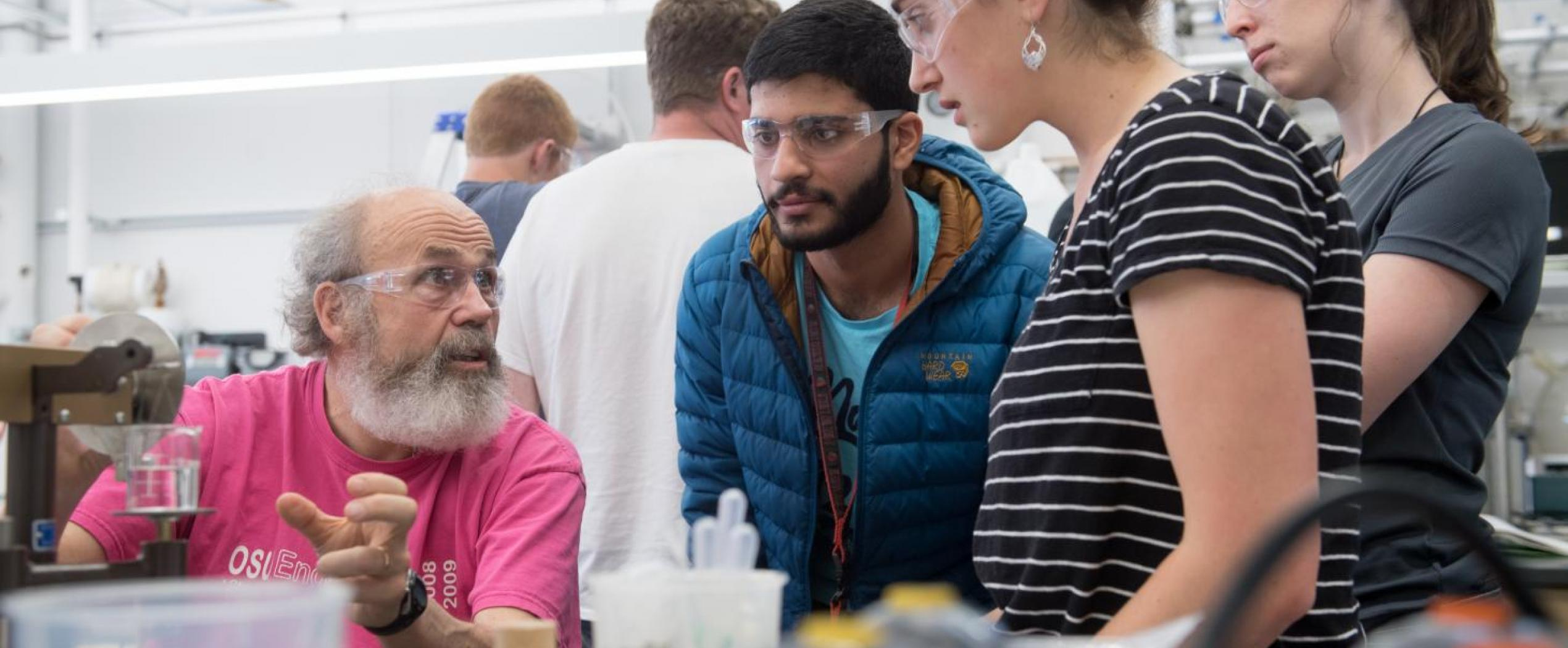 professor helping students in lab