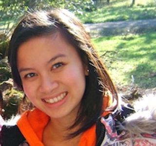 Van Ahn Vu standing outside field