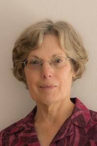 Eileen Hartmann in front of grey backdrop