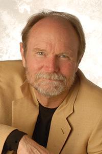 Joel Peterson in front of beige backdrop