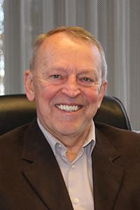Ron Schoenheit sitting in office chair