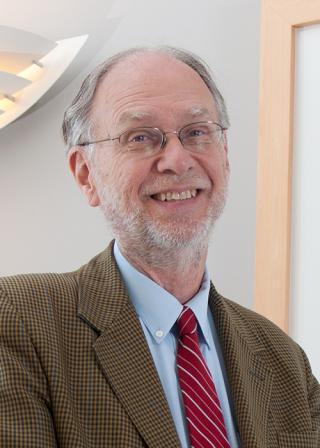 Michael Waterman standing in office space