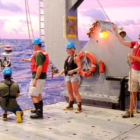 Researchers take a phytoplankton sample on an OSU research vessel.