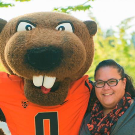 College of Science Head Advisor Heather Arbuckle smiling with Benny Beaver