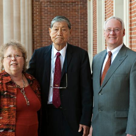 Dr. Samuel Wang with OSU's previous president Ed Ray and his wife, Beth Ray standing together along the Memorial Union Java Stop balcony.
