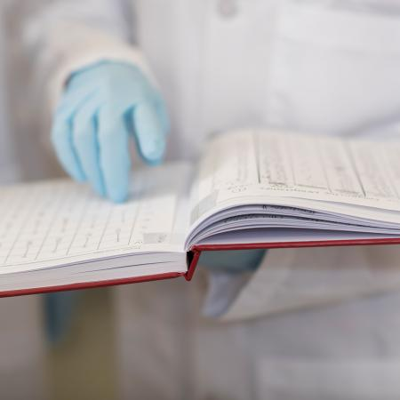 Scientist holding a lab book.