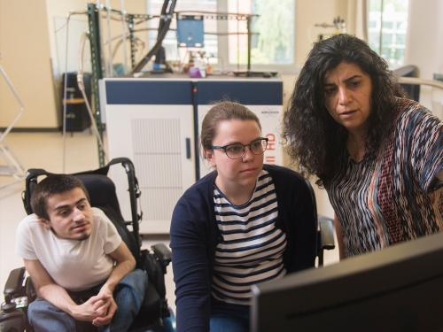 Elisar Barbar analyzing lab results with graduate students in her lab.