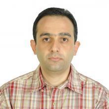 Reza Mollapourasl in front of white backdrop