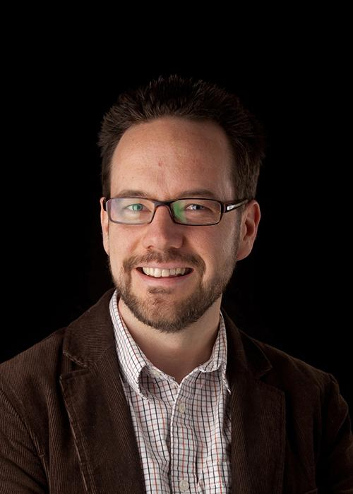 Daniel Myles in front of black backdrop
