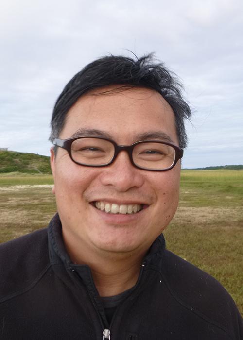 Francis Chan standing in coastal field