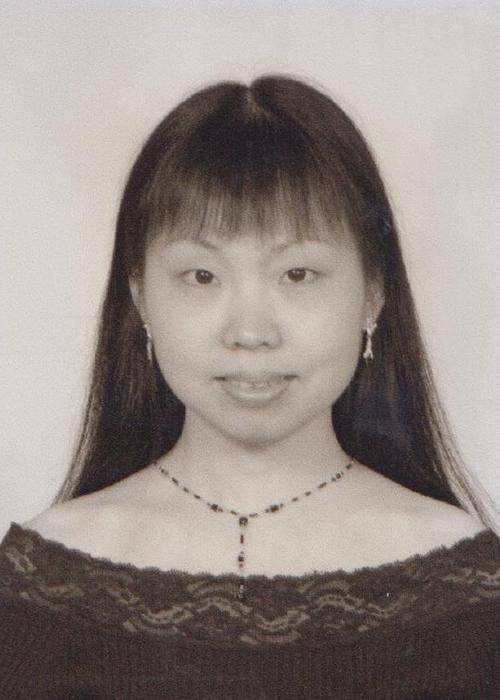 black and white photo of Jun Li in front of white backdrop