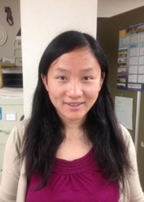 Lan Xue sitting in lab