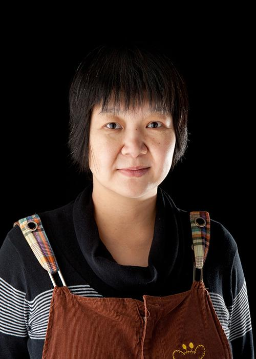 Liping Yang in front of black backdrop