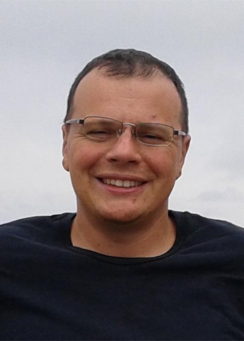 Yevgeniy Kovchegov standing outside on cloudy day