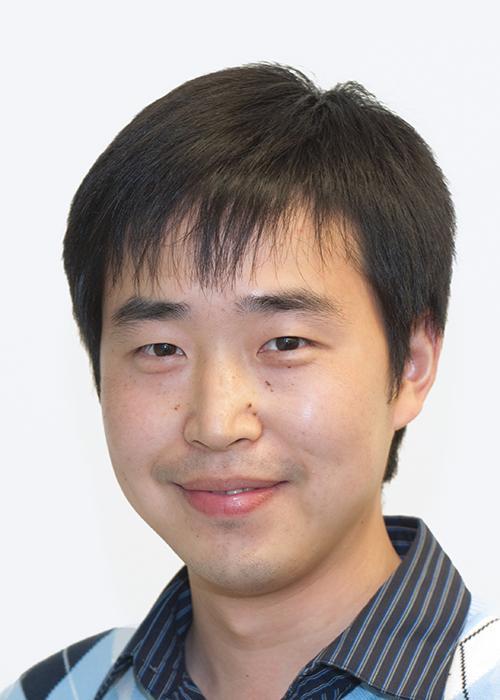 Yuan Jiang in front of white backdrop