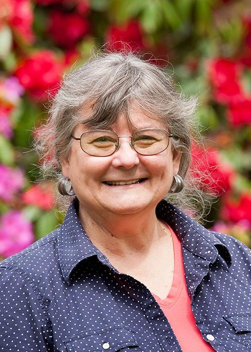 Christine Pastorek in front of rosebush