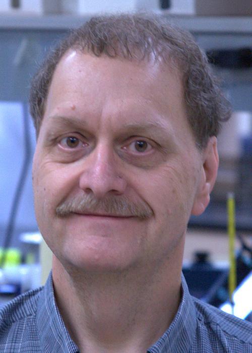 Dale Tronrud sitting in lab space