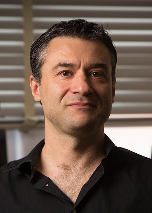 Davide Lazzati standing in office space
