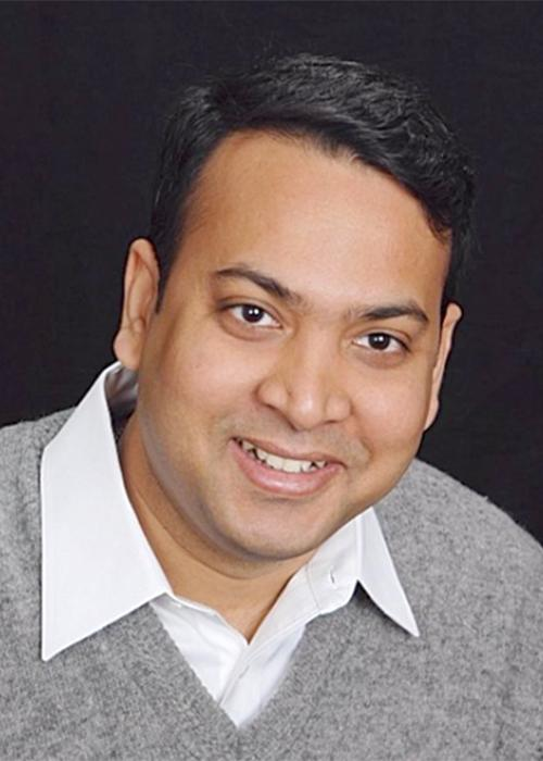 Dipankar Koley in front of black backdrop