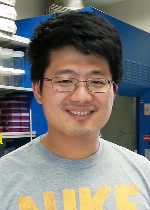Kuo-Fu Tseng standing in lab space