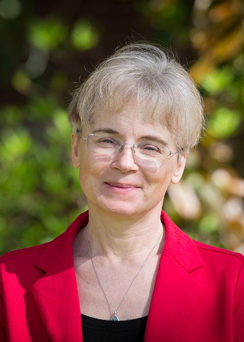 Malgorzata Peszynska in front of shrubbery