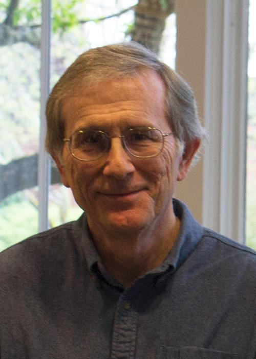 Robert Higdon sitting in front of window