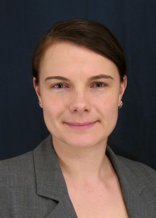 Sandra Loesgen in front of black backdrop