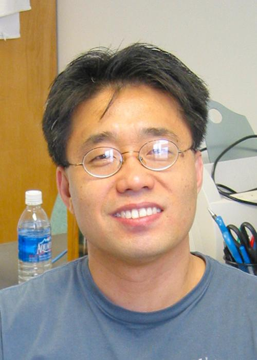 Yun-Shik Lee standing in lab space