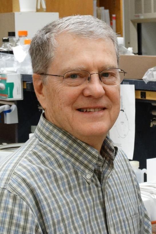 Bruce Geller sitting in lab
