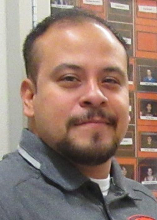 Tony Reyna standing in hallway