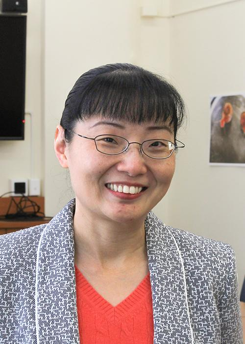 Claire Wu standing in conference room