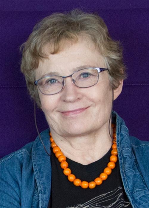 Jaga Giebultowicz in front of purple backdrop