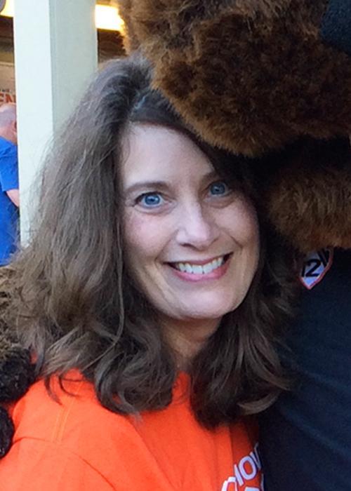 Kim McQueen hugging Benny the Beaver