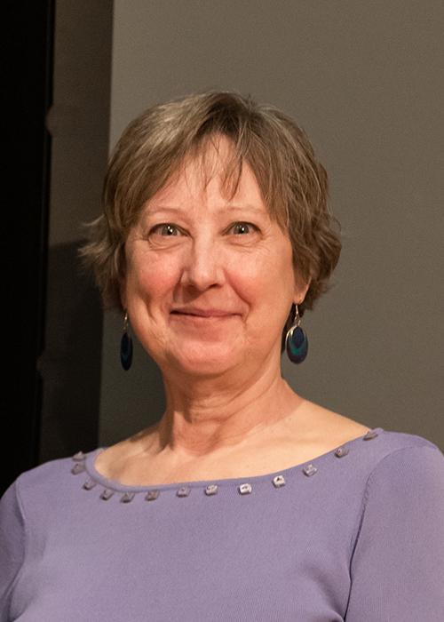 Bettye Maddux in front of grey backdrop