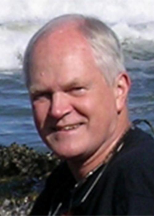 Bruce Menge in front of ocean shore