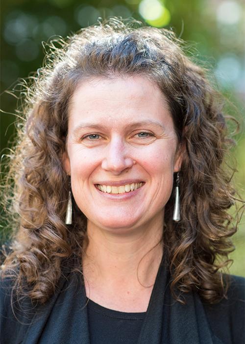 Kirsten Grorud-Colvert in front of shrubbery