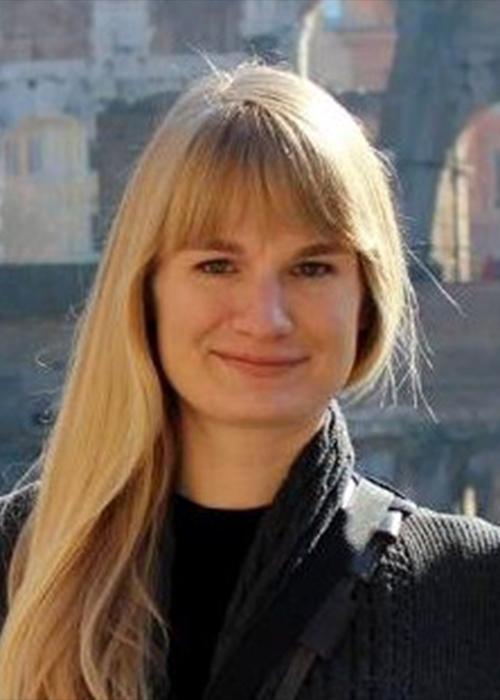 Vanessa Smilansky standing in front of buildings.